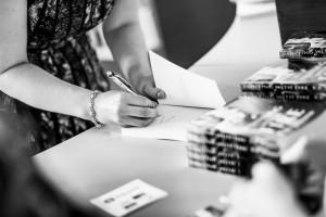 K.B. Jensen autographs her new novel at the book launch. (Photo: JonasVandall.dk)