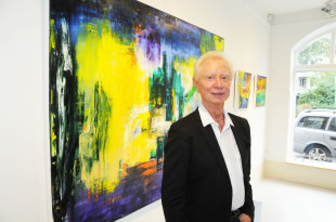 Franz Beckerlee of the famous Danish rock group GASOLIN is displaying his new art in Denmark. (Photo courtesy of Hasse Ferrold, The Danish Pioneer's Staff Photographer)