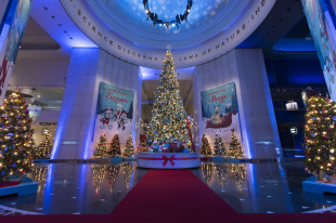 The 45-foot-tall Grand Tree in Christmas Around the World is decked in more than 30,000 lights, as well as other festive trimmings and ornaments. This year, the tree is decorated with a Disney theme in honor of temporary exhibit, Treasures of the Walt Disney Archives. (Photo courtesy of J.B. Spector, Museum of Science and Industry)