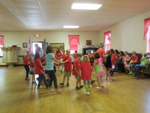 The children enjoy the dancing at the Danish Youth Camp in Michigan. (Photo courtesy of Jonna Easterby)